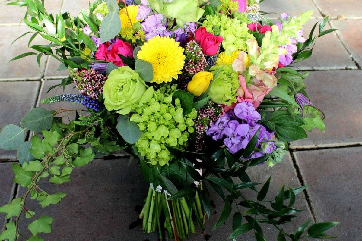 garden wedding bouquet with mist of flowers and plant greenery